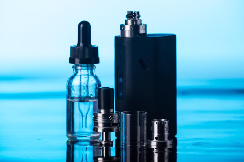 electronic cigarette on dark blue background